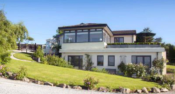 Conna home has three acres, stables and is next door to the 30-horse yard of a top Irish horse trainer